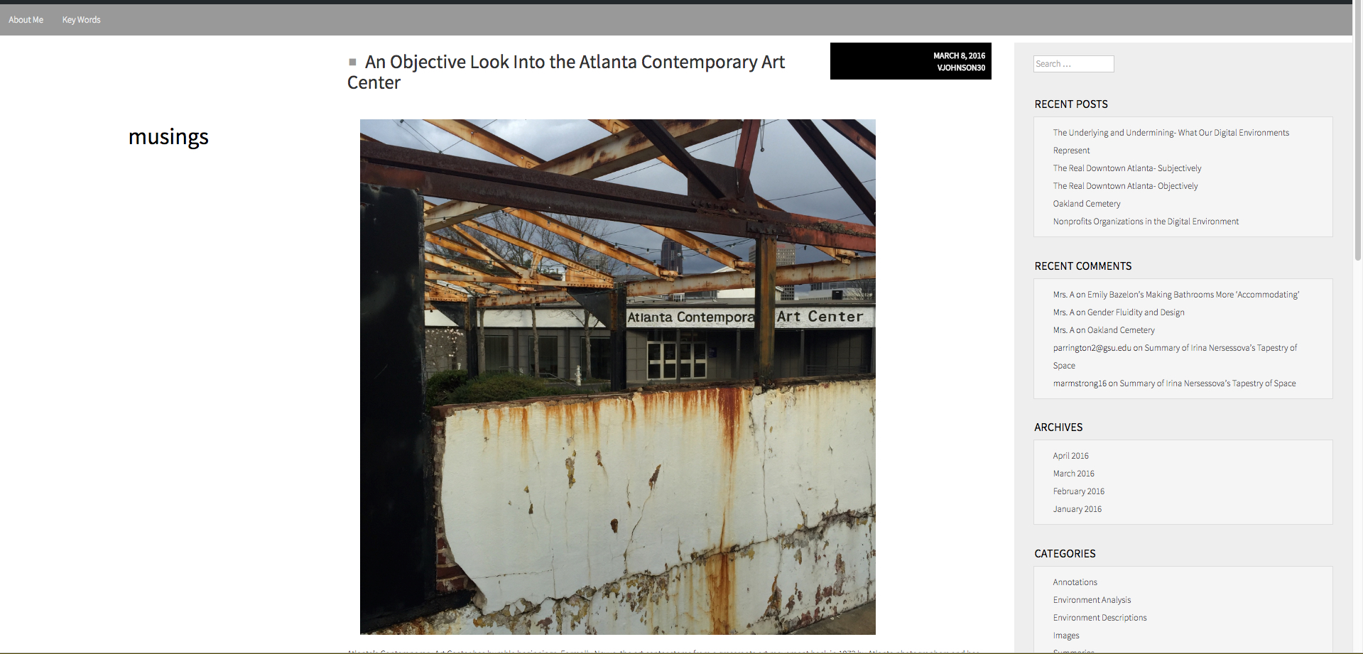 "White background. Top right, a word in small black letters reads, ""musings."" Black words at the top of the site read, ""An Objective look into the Atlanta Contemporary Art Center."" Below is a large, square photograph featuring what looks like a ruined building, and in the background is a newer building with a sign reading ""Atlanta Contemporary Art Center."" To the right is a large, light gray side bar featuring 'Recent Posts, ""Recent Comments,"" ""Archives,"" etc."